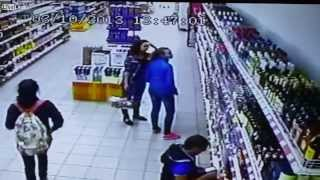 Shop Shelves Full With Alcohol Bottles Fall Almost Crushing Worker and Customers CCTV