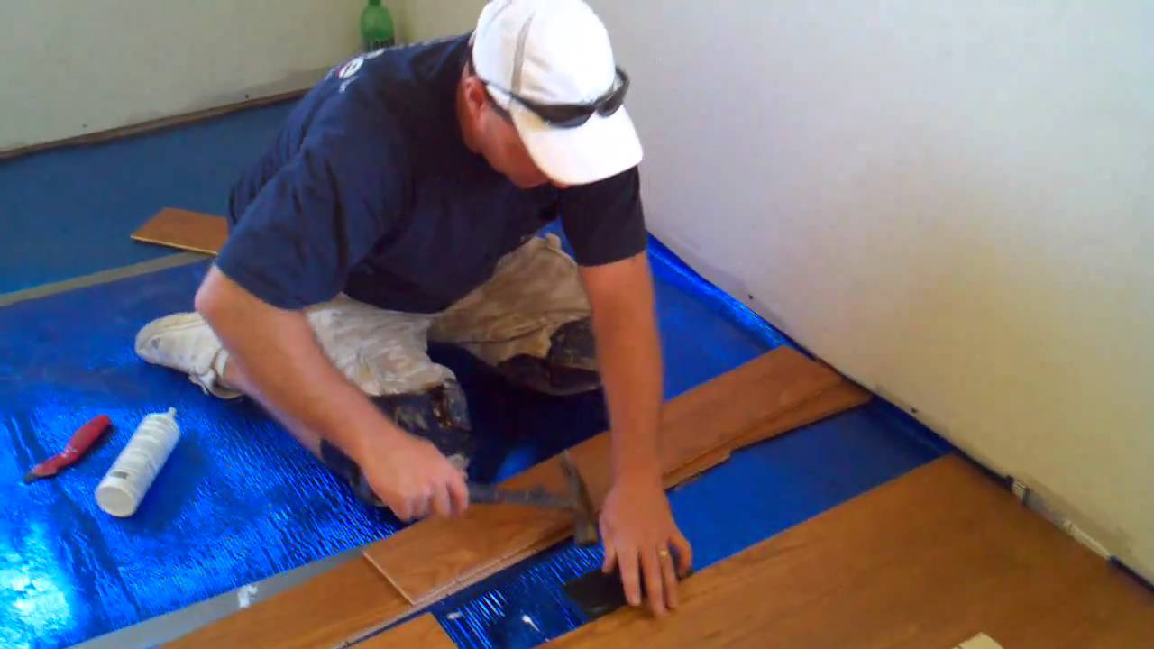 How to install a floating hardwood floor youtube how to install a floating hardwood floor dailygadgetfo Images