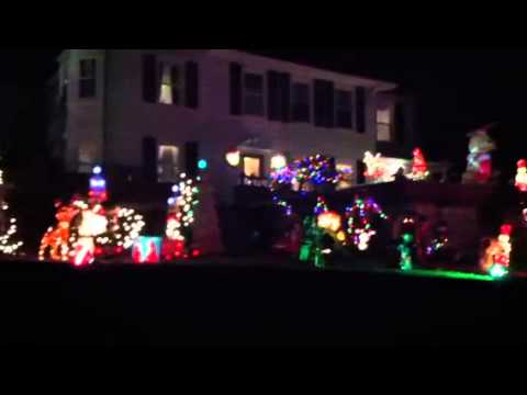 This Irvington home features reindeer, Santas and flashing lights to a holiday soundtrack.