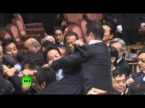 Scuffle in Japan upper house after panel approves military bills