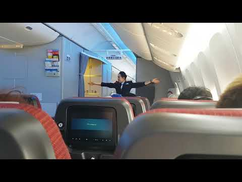 Japan Airlines safety demonstration by cabin attendant