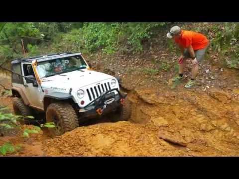 Jeep JK Wrangler Rubicon on 37s climbing at Barnwell Mountain Gilmer, Texas