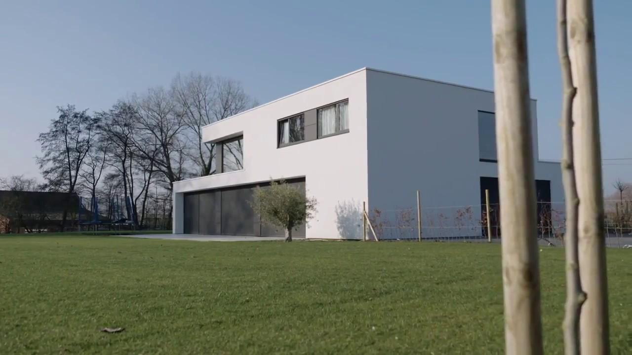 Maison à ossature bois moderne avec crépi blanc de Dewaele Ossature Bois