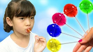 kid and Sister pretend play with Fruit Lollipops