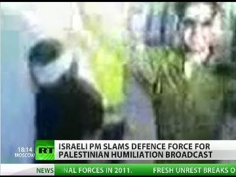 Video of IDF soldier dancing by bound Palestinian woman sparks scandal