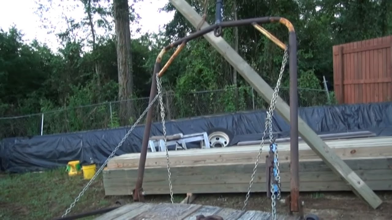 The mobile death crane and setting poles for pole barn