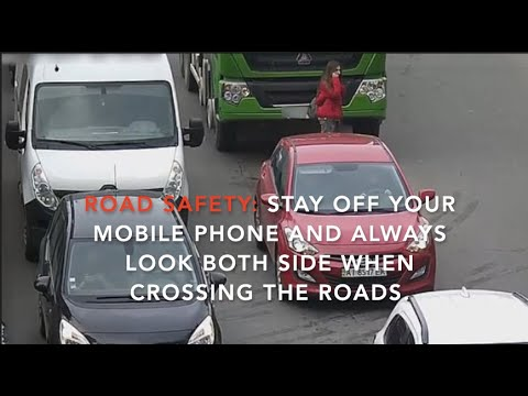 Ukrainian Woman distracted by her mobile phone whilst crossing the road look what happens..