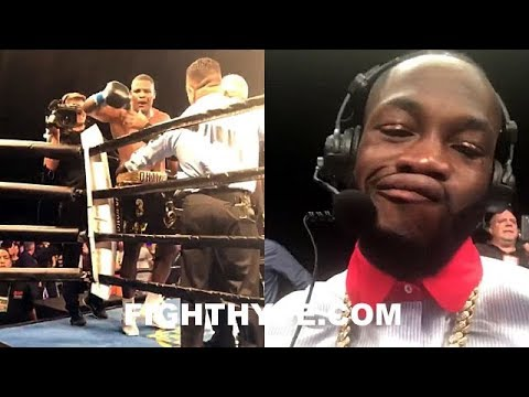 LUIS ORTIZ STEPS TO DEONTAY WILDER RINGSIDE AFTER KO WIN; WILDER LAUGHS, UNIMPRESSED BY PERFORMANCE