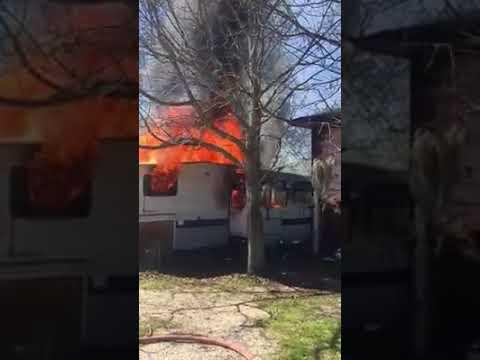 Watch Slidell camper fire threaten nearby home