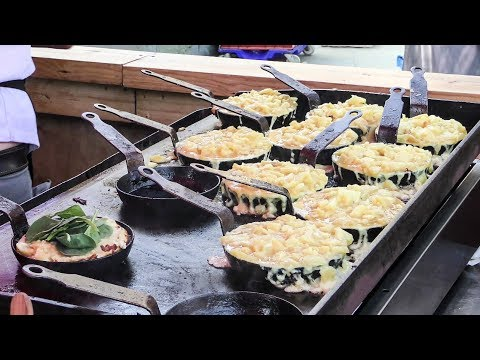 Street food Market at Partridges Market, London. Melted Cheese, Huge Beef, Oysters and More