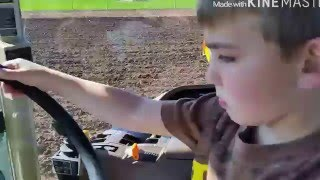 Chiseling ground with the John Deere 8320 tractor and John Deere 714 chisel/ kid driving tractor