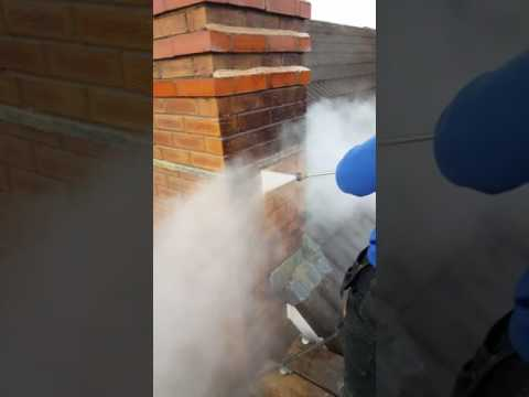 Water jetting moss from chimney stack