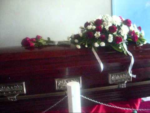GREGORY ISAACS IN HIS CASKET AT HIS FUNERAL- IN KINGSTON,JA.