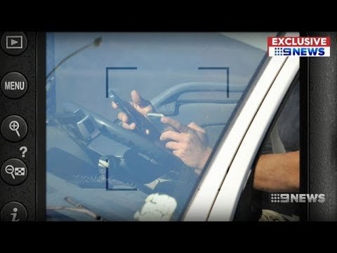 Australian truck driver caught using two mobile phones