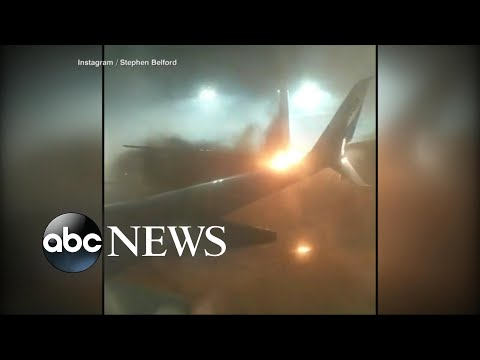 2 planes collide at Toronto airport causing the tail of one plane to catch fire