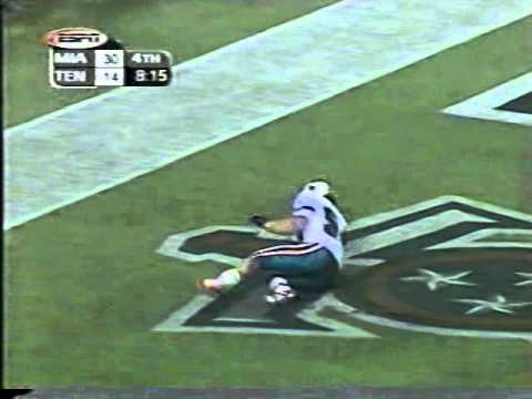 Zach Thomas somersaults into the endzone