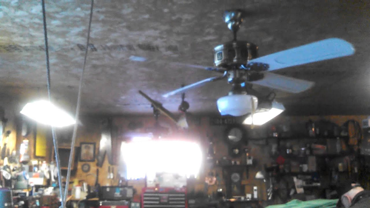 Supreme Emperor and Emerson Longnose Ceiling Fans in a garage