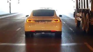 Tesla Car driving Jumeirah Palm tunnel in Dubai