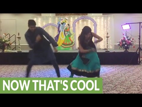 Bride and brother pull of epic wedding dance routine