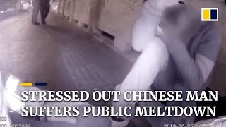 Stressed out Chinese man suffers emotional meltdown in public