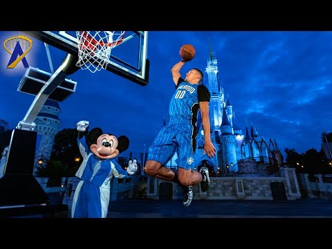 Mickey Mouse plays basketball with Orlando Magic's Aaron Gordon as part of new sponsorship