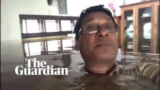 Kerala floods: man, neck-deep in water, appeals for help from inside his house