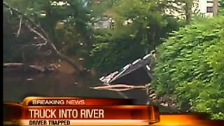 Noon: Dump truck in river