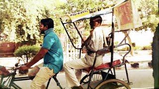 Hardworking rickshaw wala on the back seat | originals