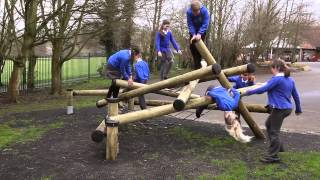 Children Having Fun On Wooden Playground Equipment (sutcliffe Play)