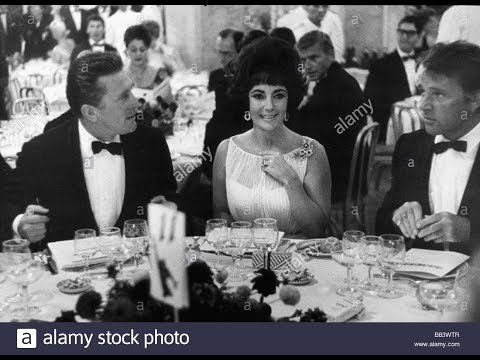 Elizabeth Taylor throws a party in honor of Kirk Douglas
