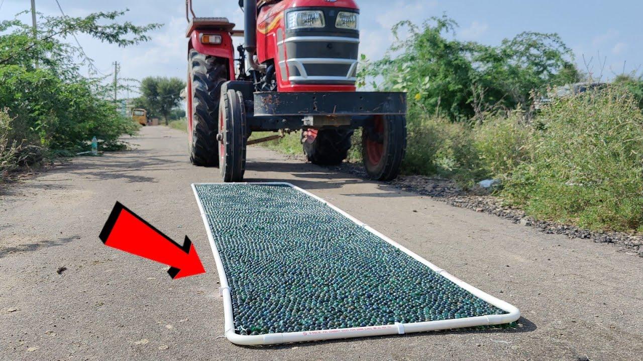 20 हजार काँच के कंचो पर चला दिया ट्रेक्टर - Driving Tractor On 20 Thousand Glass Marbels