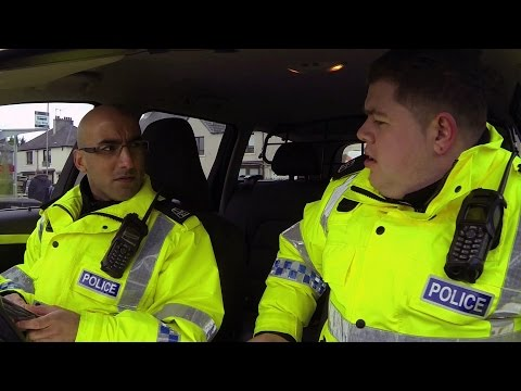 Pirated CDs brightens up the day for PCs Hugh McKirdy (Grado) and Surjit Singh - Scot Squad