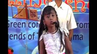 8 year old girl of Indian whistlers` association whistling to the t...