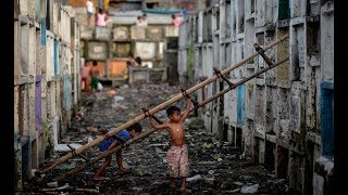 ЖИЗНЬ РЯДОМ С ТРУПАМИ в МОГИЛЬНЫХ СКЛЕПАХ и причем  тут Россия - Манила Филиппины