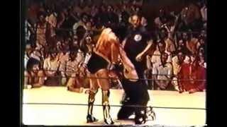 Masked Superstar vs BlackJack Mulligan in a  lumberjack match. Mulligan unmasks The Superstar 1978