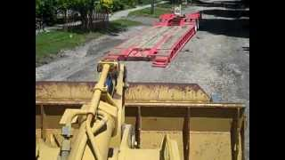 Loading and riding along in a cat 963 b track loader
