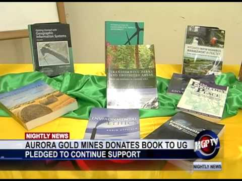 AURORA GOLD MINES DONATES BOOK TO UG