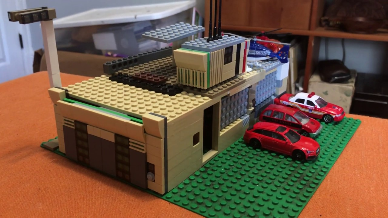 A mini scale LEGO fire station I built ( about 1:64 scale)