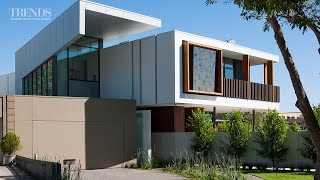 Modern Home With Central Spine Responds To Site. Timber Verandah Call To Mind Victorian Homes