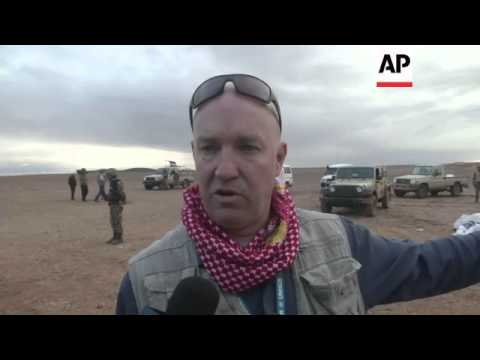 Syrian refugees arrive at illegal crossing point near the Iraqi-Syrian border
