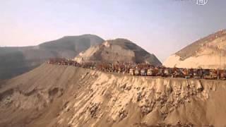 China: Berge weichen Stadt