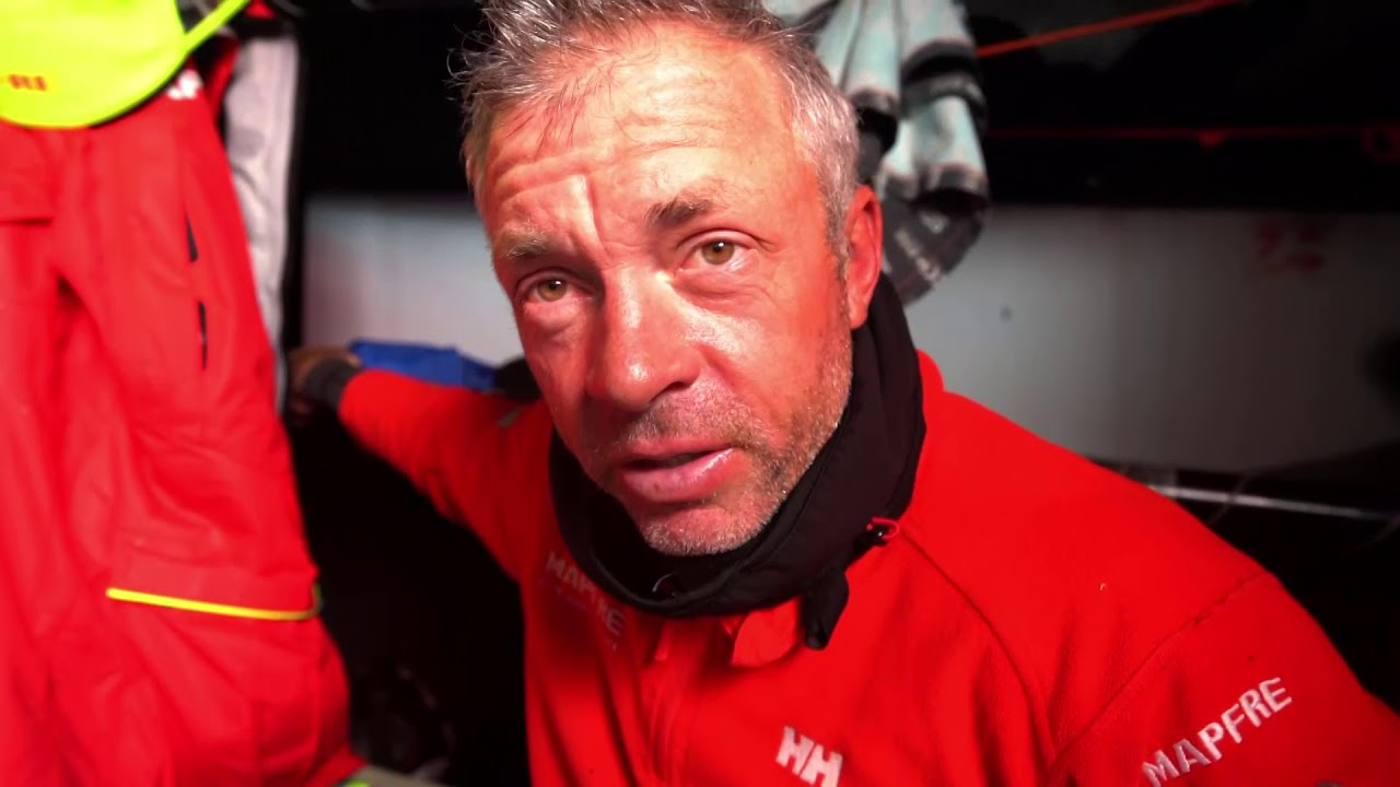 Joan talks below in Spanish. Lots of mention of wind. Rob, below: Right now we're not in great shape. The leaders, first 3 boats, have extended quite a lot. That may change in the ridge. Dongfeng not that far away. Scallywag probably going to overtake us in the next sched. Dee not far away. Podium still a possibility, but we're going to have to get some luck with the upcoming ridge. Joan talks more in Spanish; discusses the limit of the Gulf Stream. Rob: Had a very cold night last night. Water was down to zero at one stage. Passed an iceberg; could see it on the radar. Water's probably 10 or 12 now. More Joan in Spanish. Washing machine shots of the cockpit from the hatch. Slomo washing machine. Neti grinding. Crew putting on foulies below. Stern cam shots of big spray. Sail change: Hoisting the FR0. Sophie wrestling the sail. Spreader cam shots of the sail change. Drone shots of them triple-heading wiht the FR0 and full main: Must be in lighter wind than some of the other boats. Looks like 20 knots of wind or less from the sea surface. Favoriting for those drone shots at the end.