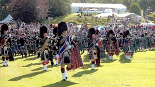 Massed pipe bands display as The Queen & Royal Family leave the 2019 Braemar Gathering in Scotland