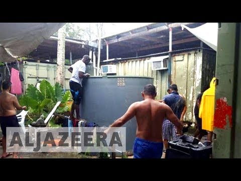 Manus Island refugees dig for water as Australia closes camp