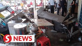Cook killed after car crashes into eatery in Kampar