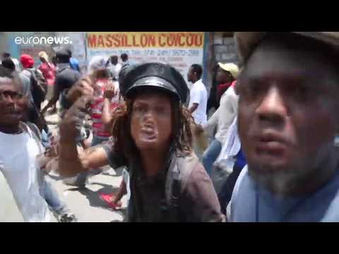 France 24:Haitian capital halted as protesters call for president to quit