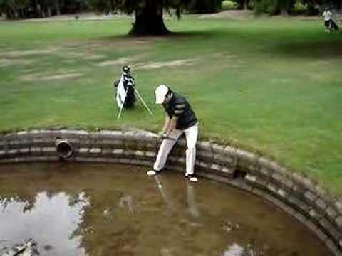 golfer deals with water hazard