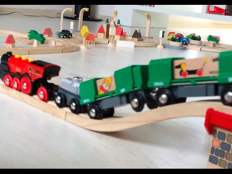 BRIO Plan City Toy cargo trains trucks are riding on the wooden – Plan Toys Garage Road System