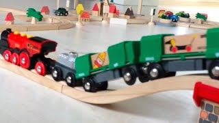 Brio & Plan City Toy Cargo Trains & Trucks Are Riding On The Wooden Rail And Road In The Mini Town.