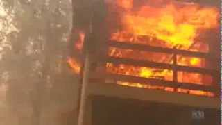 NSW man tries to defend home as fire takes hold